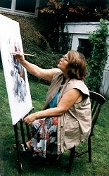 at the easel in her garden